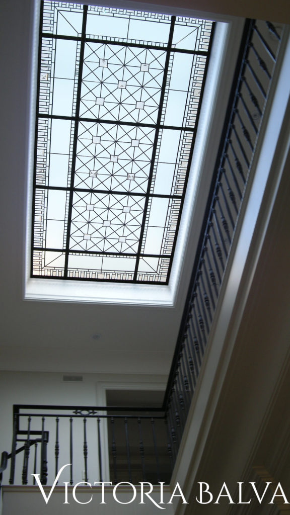 stained and leaded glass ceiling skylight with coloured and clear bevelled glass and large custom made crystal jewels in simple geometric glass design
