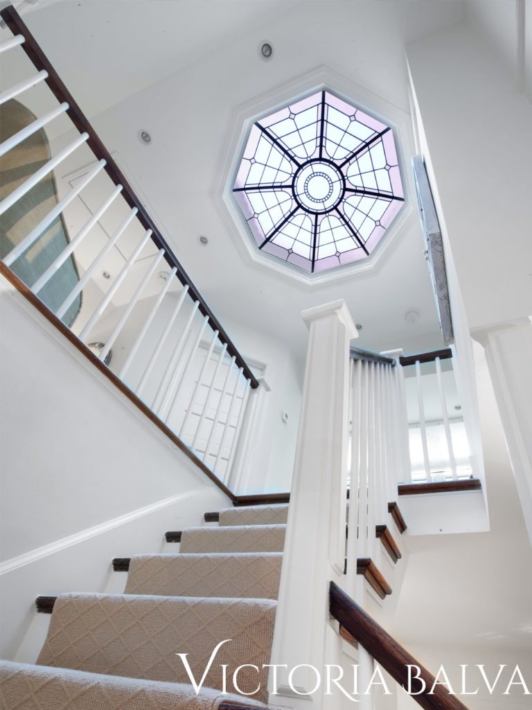 Stairwell with octagonal stained glass ceiling skylight