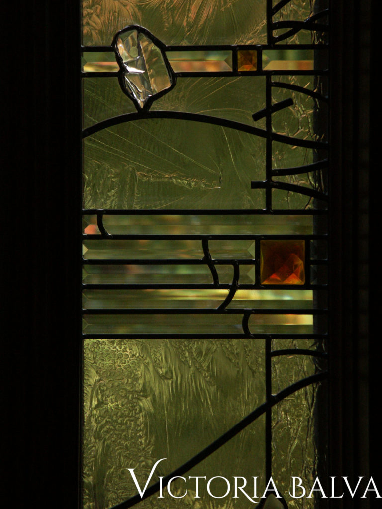 Bevelled glass, fused kiln formed glass in modern stained and leaded glass window
