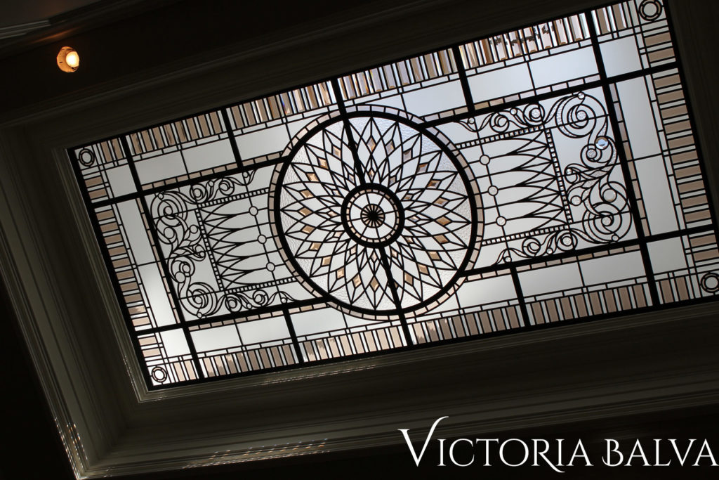 Large decorative glass ceiling with clear textured glass and bronze bevelled glass accents